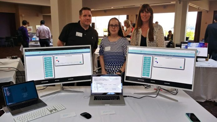 Boot camp participants show off their final project at the University of Washington Coding Boot Camp Demo Day on May 30, 2019.